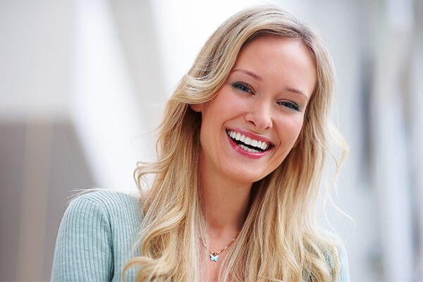 A long-haired blonde woman smiling