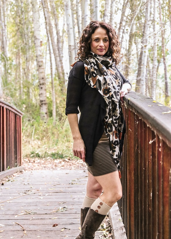 Our team member, Dr. Stacey Gividen standing in front of a wooden bridge